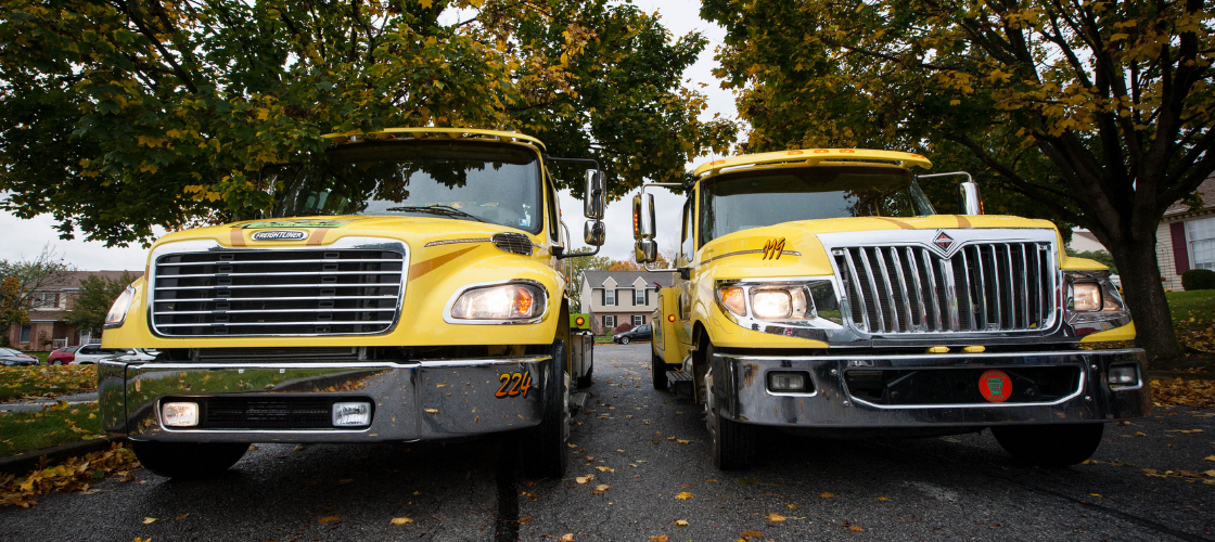 two heavy duty A1 towing trucks parked