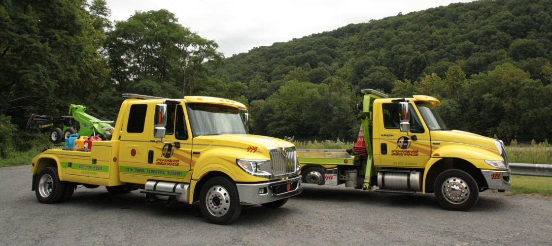 A-1 towing services bright yellow trucks