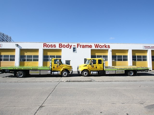 picture of building with two trucks in front