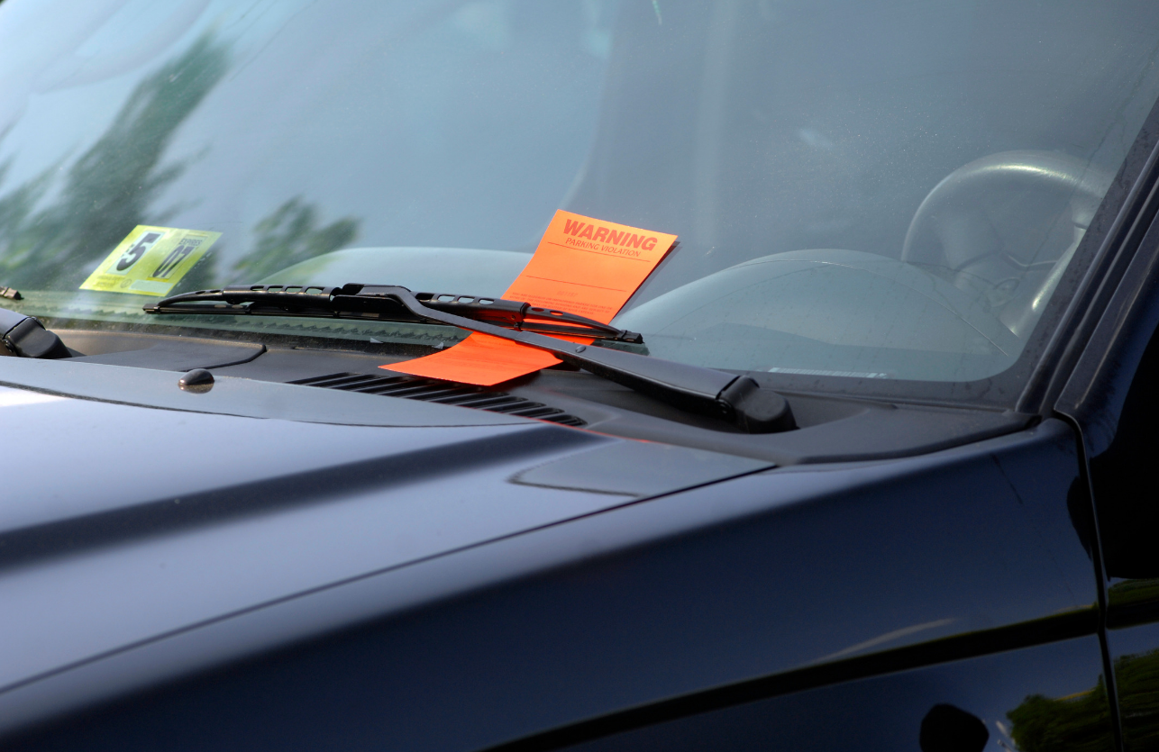 picture of a car with a ticket on windshield