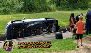 With People looking Towing-Services 18103 of Jeep lying in water Fish Hatchery
